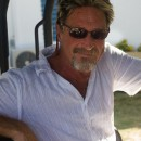 McAfee co-founder on the run from Belize authorities