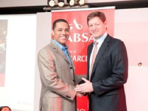 Stafford Masie, CEO and founder of thumbzup, with Arrie Rautenbach, Absa Head of Retail Markets (image: Absa)
