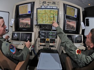 Airman 1st Class Caleb Force assists 1st Lt. Jorden Smith, a MQ-1B Predator pilot, in locating simulated targets during a training mission (image: U.S. Air Force/Senior Airman Nadine Y. Barclay)