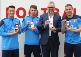 Mesut Ozil, Aaron Ramsey, Mark Mitchinson of Huawei and Lukas Podolski showcase the Huawei Ascend P6 smartphone (image: Huawei)