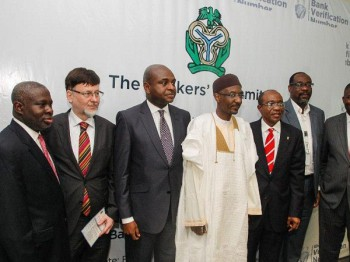 Group photo at the opening ceremony of the DERMALOG biometric system for Nigeria's banks - including the Governor of the Central Bank, Sanusi Lamido Sanusi (centre), and the CEO of DERMALOG, Günther Mull (second from left). (Image source: Dermalog Identification Systems)