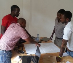 Members of the access.mobile team strategise. (Image source: access.mobile)