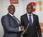 Mastercard-Regional-Vice-President-James-Wainana-left-hands-over-the-Certificate-to-GT-Bank-Kenya-MD-Adekunie-Sonola