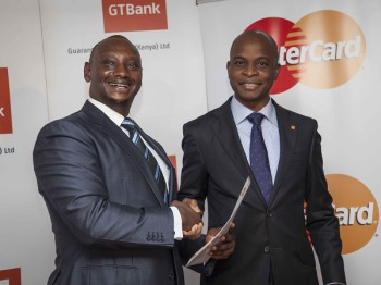 Mastercard Regional Vice President James Wainana (left) hands over the Certificate to GT Bank Kenya MD Adekunie Sonola (image: supplied)
