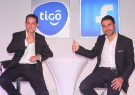 Tigo Tanzania General Manager, Diego Gutierrez (L), and Facebook representative, Nicola D'Elia, during the launch of a historic partnership between their two companies today in Dar es Salaam