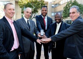 Pictures R to L: Clayton Booysen(IBM) Werner van der Westhuizen( Road Buddy Inventor) Tiyani Rikhotso( Chief Director of Communications, Ministry of Transport), DG Mawethu Vilana (Director General of the Department of Transport) and Gary Ronald (Independent Road Safety Expert)