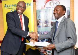 Kris Senanu Deputy Chief Executive AccessKenya Group and Dr. Tom Musili, Executive Director Computer for Schools Kenya exchange documents after signing an Memorandum of Understanding that will see AccessKenya fund the training of 200 principals on the use of technology in classrooms at a cost of Kes 1.2 million this year
