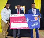 Norman Muga of Strathmore University and Mburu Njunge of Kenyatta University - winners of the 2015 Strathmore- Waterloo Universities Agribusiness Mobile App challenge -  pose for a photo with Principal Secretary Ministry of Information and Communication Dr. Victor Kyalo last week  when they received their prize.
