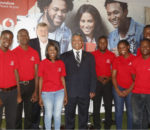 Hon. Given Lubinda and CEO Lars Stork pose with Vodafone Zambia Brand Ambassadors.