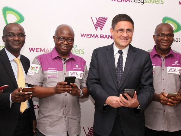 (l-r): Chief Product and Information Officer, Etisalat Nigeria, Otuyemi Otule;Managing Director and Chief Executive Officer, Wema Bank Plc, Segun Oloketuyi; Chief Executive Officer, Etisalat Nigeria, Matthew Willsher and Head of Retail, Wema Bank PLC, Dotun Ifebogun doing a product demonstration at the unveiling of WemaEasySavers Account by the companies in Lagos on Thursday.