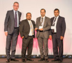 Prabu Balasubramanyan, Executive Director, TransSys Solutions (second from the right) receives the award on behalf of the company