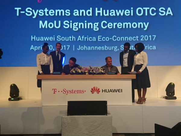 Gert Schoonbee, T-Systems and Alex Du, Huawei signing the official partnership documents at Huawei Eco-Connect in Sandton.