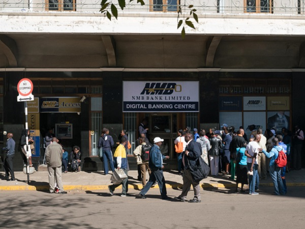 People line up to use an ATM at NMB bank in Harare