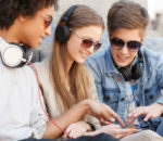 Young people consuming media on mobile phone
