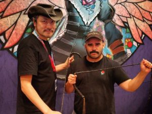 Koji Igarashi (left), creator of Bloodstained: Ritual of the Night poses with a fan